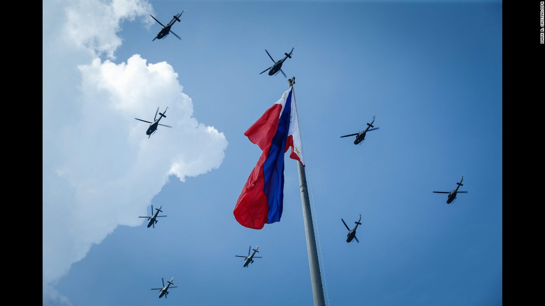 Helicopters perform a flyby during Independence Day ceremonies in Manila, Philippines, on Sunday, June 12.