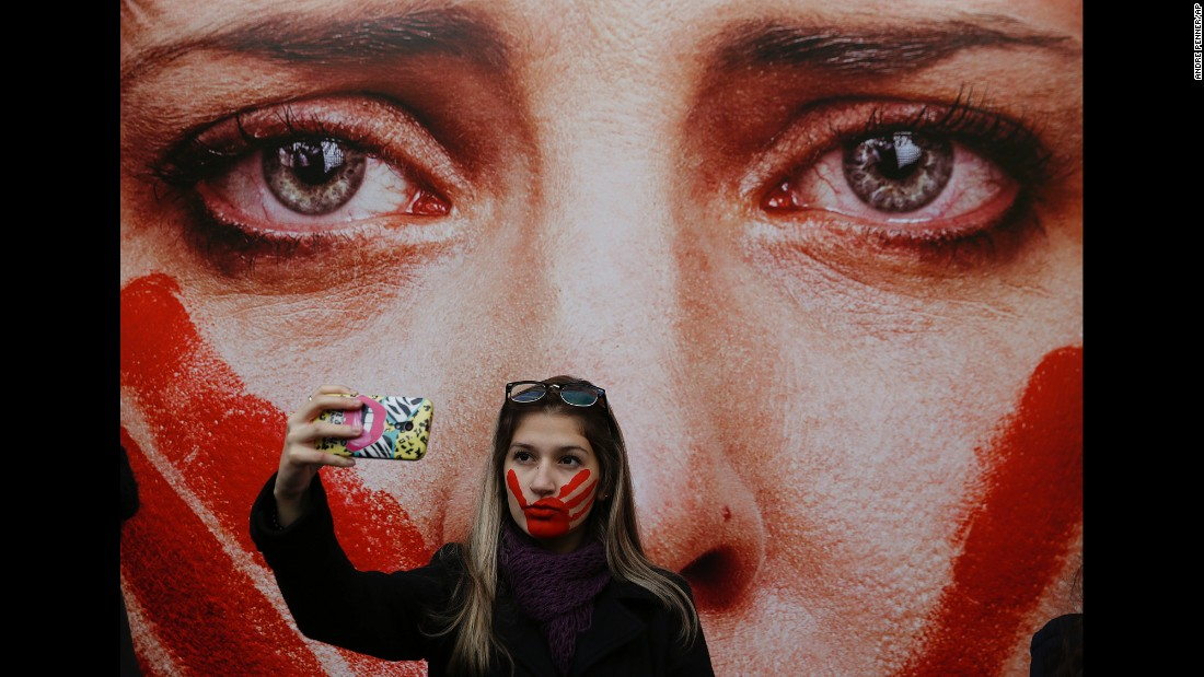 "An activist in Sao Paulo, Brazil, takes a selfie Friday, June 10, during a protest against rape and violence against women. The protest comes weeks after <a href=""http://www.cnn.com/2016/05/30/americas/brazil-gang-rape-victim-speaks/"" target=""_blank"">a 16-year-old girl was reportedly gang-raped</a> in Rio de Janeiro."