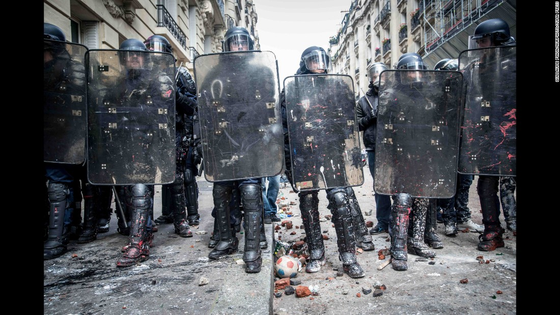 Riot police line up in Paris during a demonstration against labor law reforms on Tuesday, June 14.