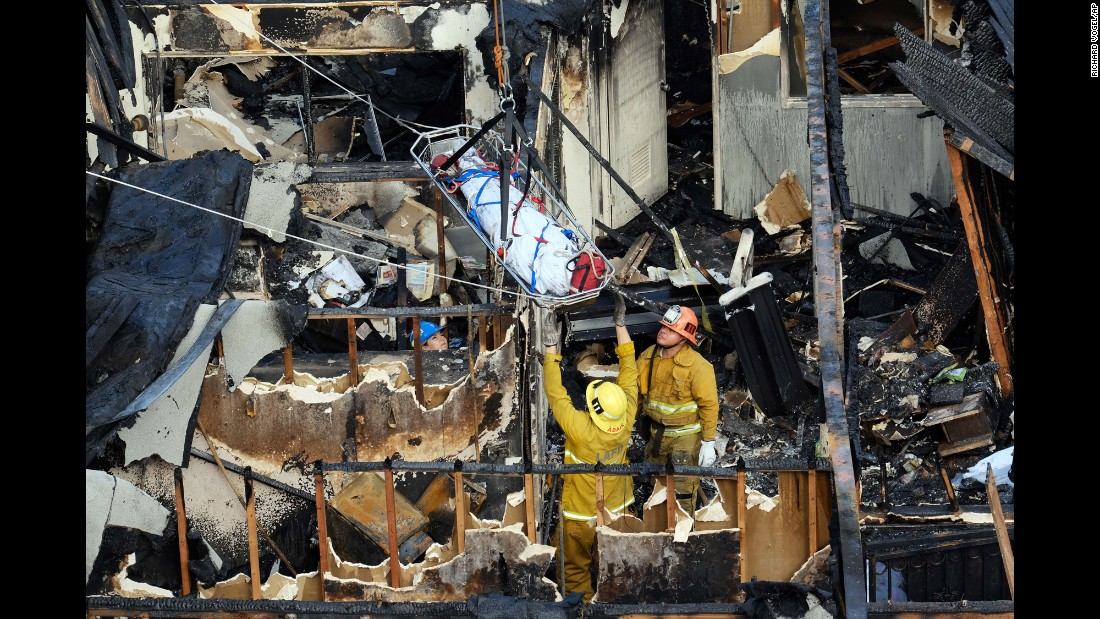 "Firefighters remove one of the five bodies found in the burned-out ruins of an abandoned office building in Los Angeles on Tuesday, June 14. A homeless man <a href=""http://www.dailynews.com/general-news/20160614/homeless-man-arrested-for-allegedly-setting-westlake-fire-that-killed-5"" target=""_blank"">has been charged with murder</a> after allegedly setting the building on fire."