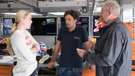 The skiier chats to Austrian racer Patrick Friesacher and Red Bull advisor Helmut Marko.