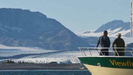 President Barack Obama looks at Bear Glacier during a 2015 tour of Alaska's Kenai Fjords National Park.