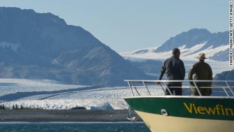 US President Barack Obama looks at Bear Glacier during a boat tour of the Kenai Fjords National Park on September 1, 2015 in Seward, Alaska. Bear Glacier is the largest glacier in Kenai Fjords National Park.