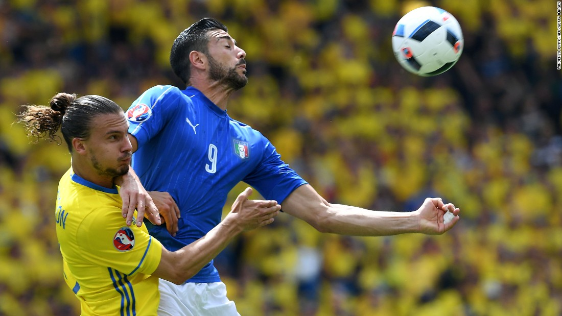 Pelle and Swedish defender Erik Johansson compete for a ball.