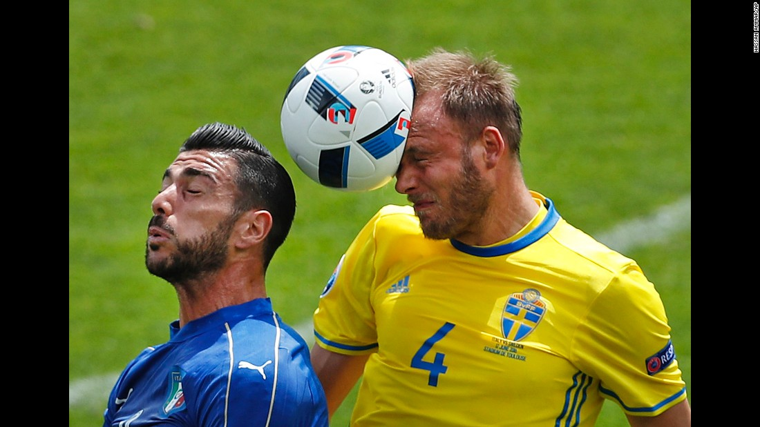 Sweden's Andreas Granqvist, right, wins a header over Italy's Graziano Pelle.