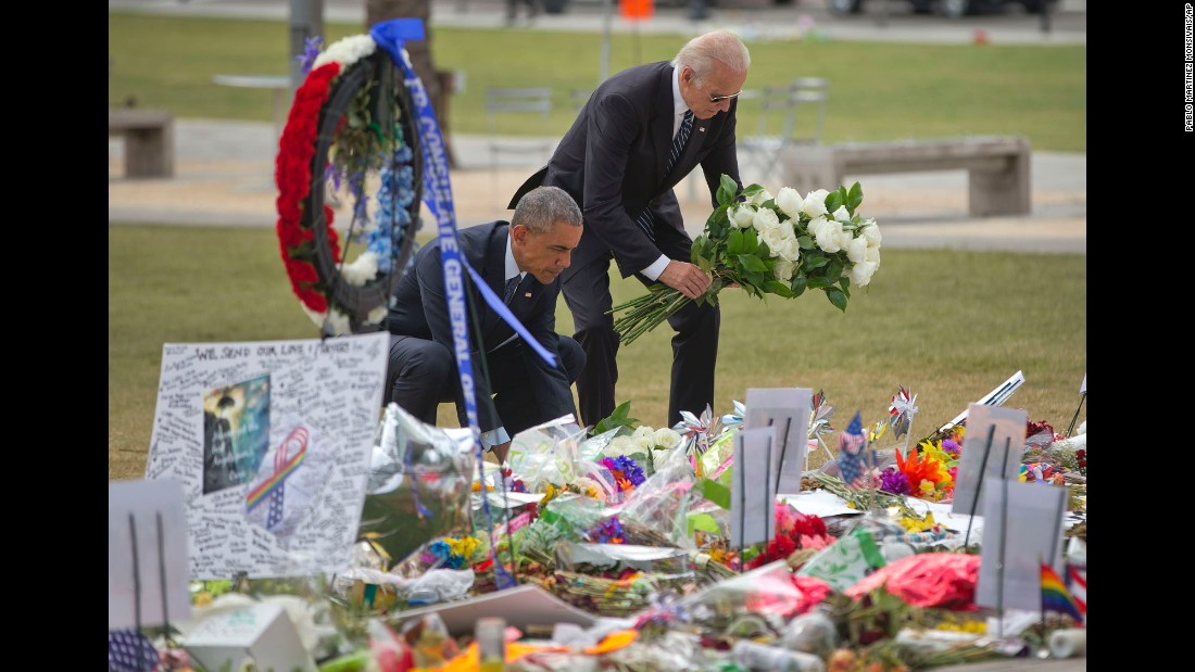 "U.S. President Barack Obama and Vice President Joe Biden place flowers at a memorial Thursday, June 16, for the victims of the nightclub shooting in Orlando. <a href=""http://www.cnn.com/2016/06/12/world/gallery/orlando-shooting-reaction/index.html"" target=""_blank"">See more reaction from around the world</a>"