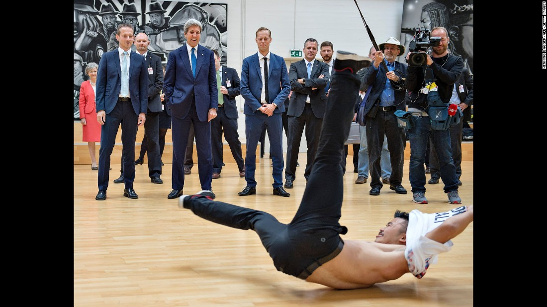 Danish Foreign Minister Kristian Jensen, left, stands next to U.S. Secretary of State John Kerry as a break-dancer performs in Copenhagen, Denmark, on Friday, June 17.
