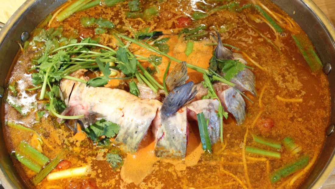 Sour fish soup is Guizhou's best known dish. It's often served on a burner at the table to let the pungent flavors develop.