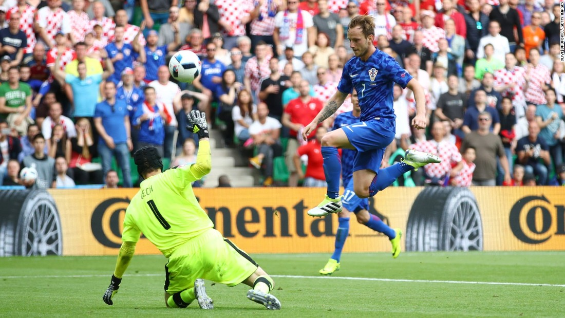 Rakitic chips his goal over Czech goalkeeper Petr Cech.