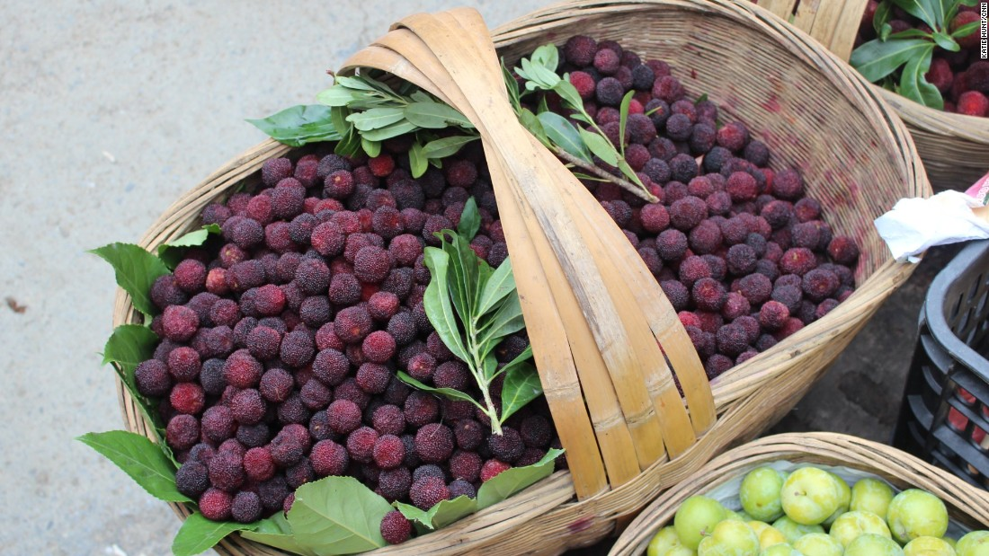 Guizhou is home to unusual vegetables and fruits like the yangmei -- the bayberry or Chinese strawberry -- that are sold from wicker baskets at local markets.