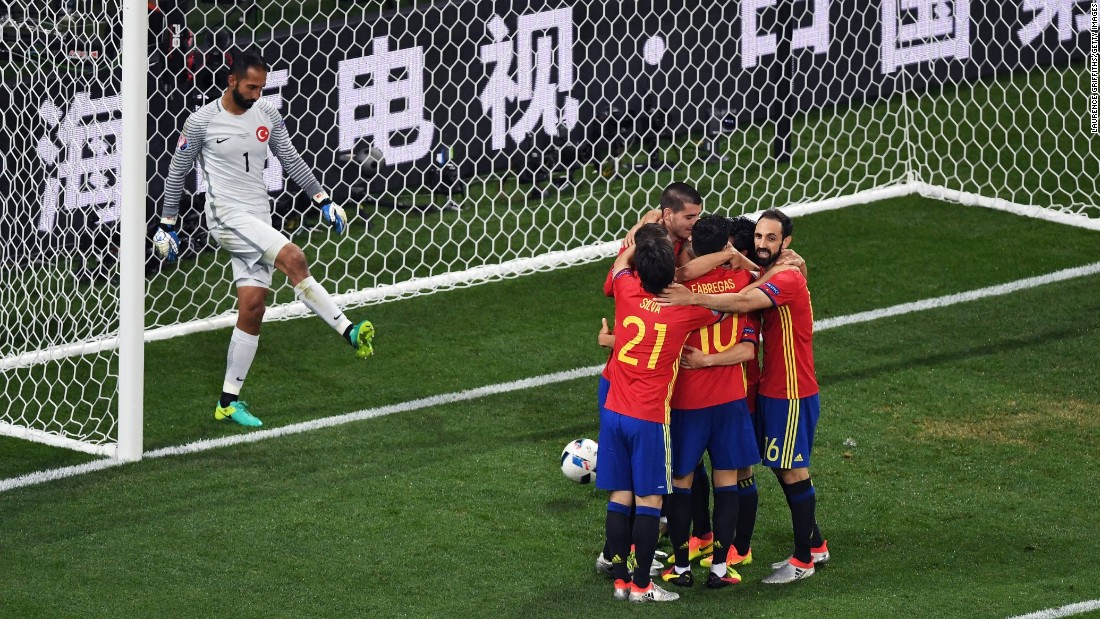 Spanish players celebrate after Alvaro Morata's second goal gave them a 3-0 lead over Turkey on Friday, June 17. Spain cruised to victory and clinched a spot in the tournament's knockout stage.