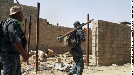 Troops from the Iraqi Federal Police engage in a battle with ISIS militants in Falluja