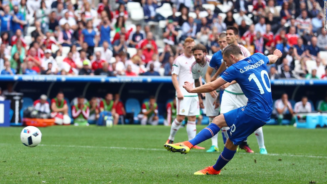 Gylfi Sigurdsson of Iceland scores a goal from the penalty spot.