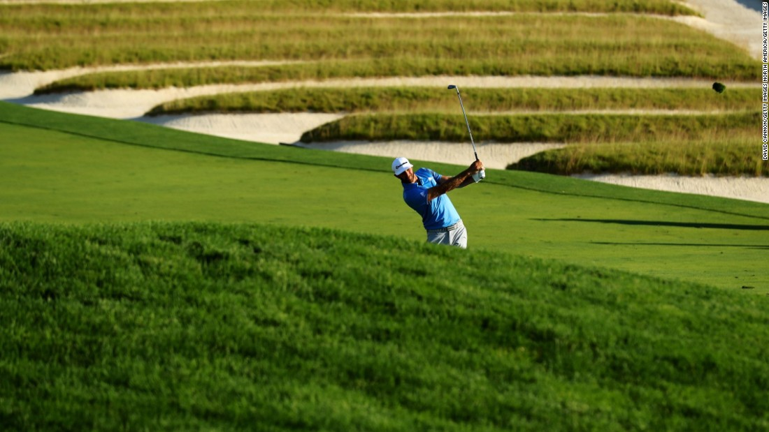 Dustin Johnson hits a shot on the third hole during the second round on Friday, June 17.