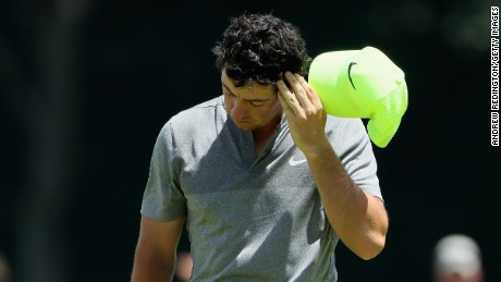 A deflated Rory McIlroy walks off his final hole of the second round at the U.S. Open having missed the cut.