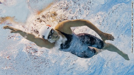 In a picture taken with an underwater camera Yvette Kong Man-Yi of Hong Kong competes in the women's 200m individual medley heats in the swimming event of the 16th Asian Games in Guangzhou on November 18, 2010.   AFP PHOTO / FRANCOIS XAVIER MARIT (Photo credit should read FRANCOIS XAVIER MARIT/AFP/Getty Images)
