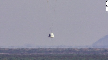 Private space company Blue Origin landed an unmanned space capsule with one of three chutes closed to test emergency capabilities.