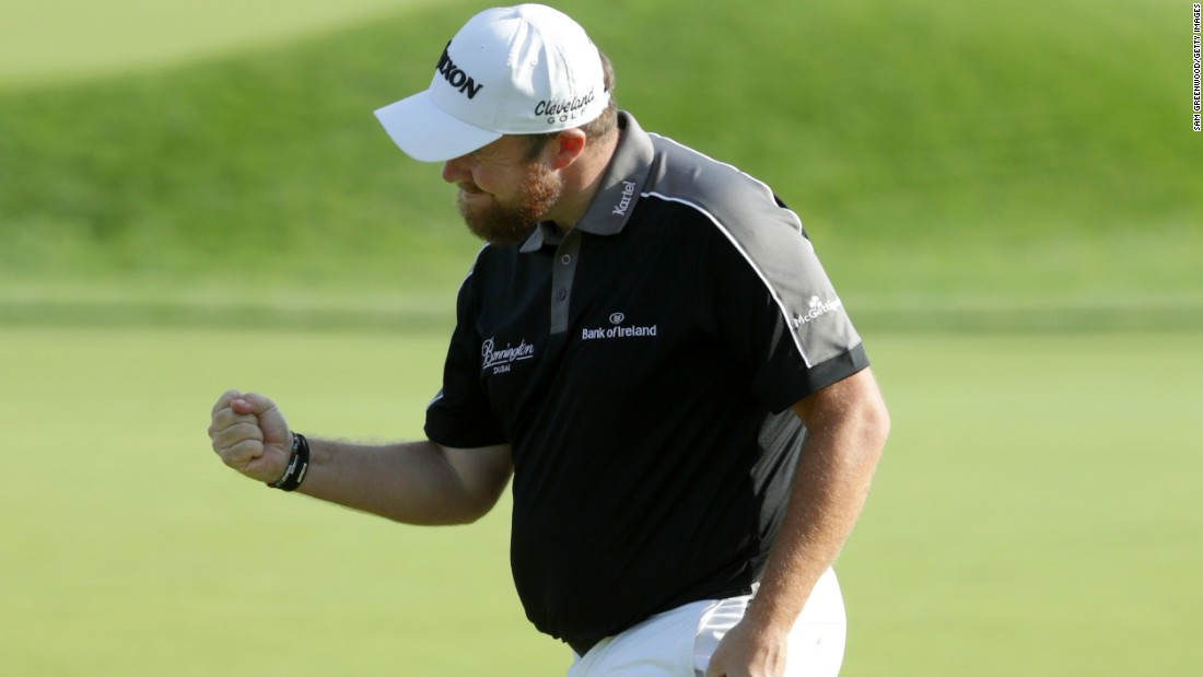 Shane Lowry celebrates his putt on the 18th during the third round on June 19.
