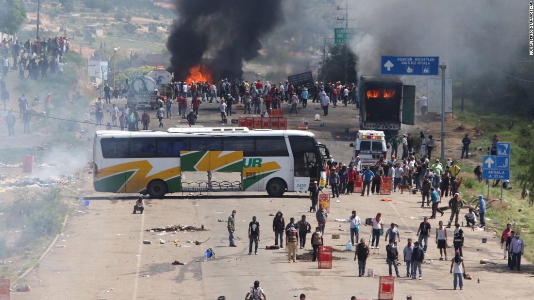 Demonstrating teachers block a highway in Oaxaca on June 19.