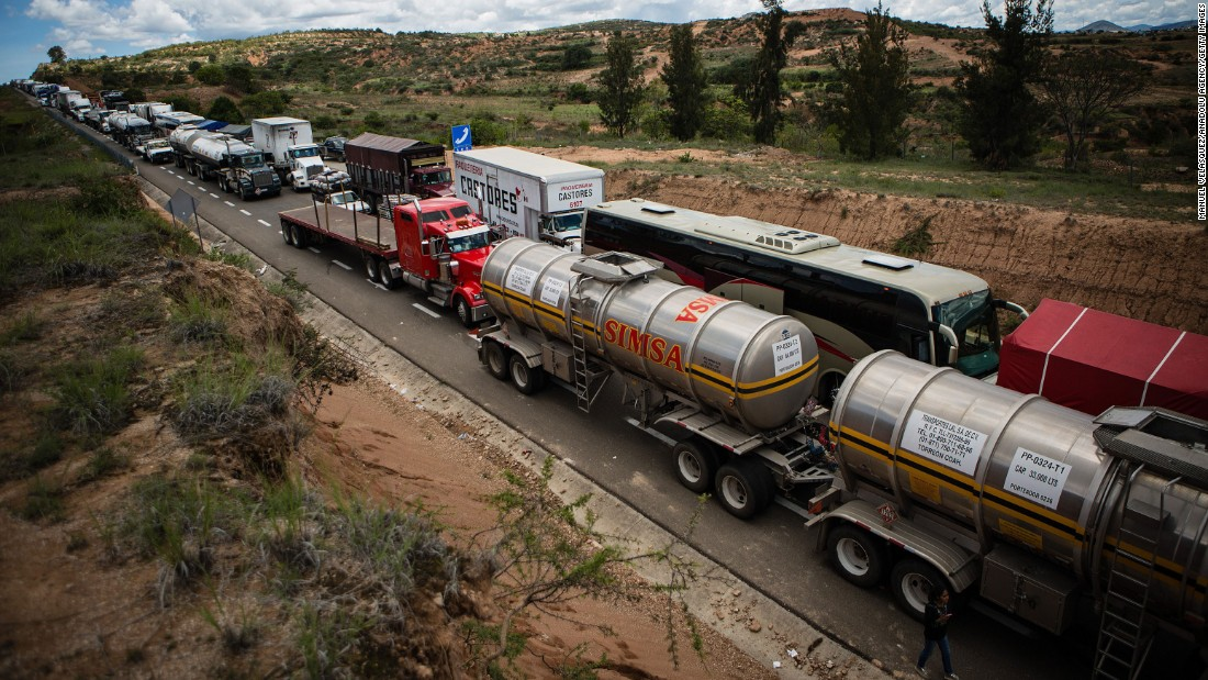 Protests stop cars and trucks on a highway in Oaxaca leading to Mexico City on Wednesday, June 15.