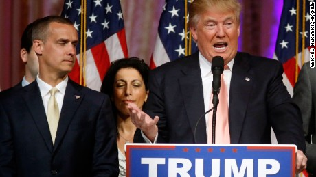 Republican presidential candidate Donald Trump speaks to supporters at his primary election night event at his Mar-a-Lago Club in Palm Beach, Fla., Tuesday, March 15, 2016. At left is his campaign manager Corey Lewandowski. (AP Photo/Gerald Herbert)