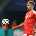 Valon Behrami deflated football