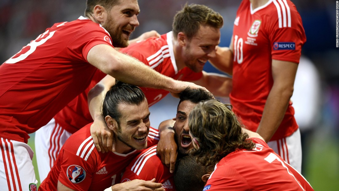 Wales celebrates the second goal of the match, which was scored by left back Neil Taylor in the first half.