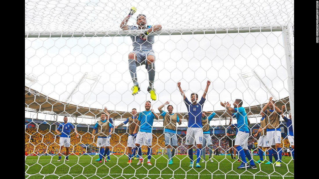 "Italian goalkeeper Gianluigi Buffon celebrates with teammates Friday, June 17, after Italy defeated Sweden 1-0 in Euro 2016. With <a href=""http://www.cnn.com/2016/06/17/football/gallery/euro-2016-day-8/index.html"" target=""_blank"">the victory,</a> Italy assured itself a spot in the knockout stage."