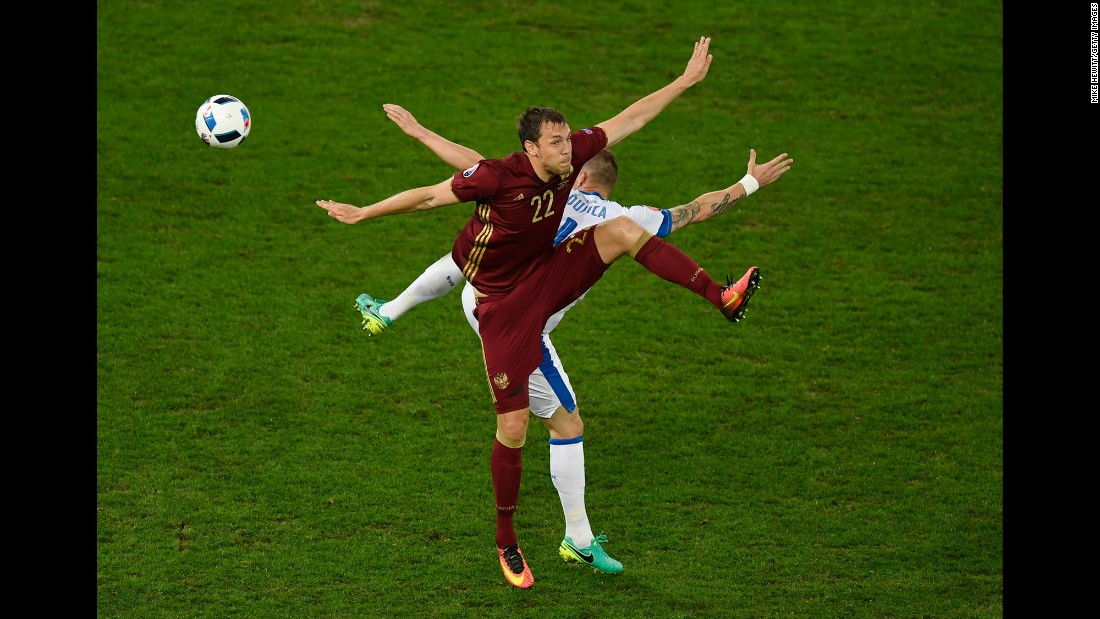 Russia's Artem Dzyuba, front, and Slovakia's Jan Durica compete for a ball Wednesday, June 15, during a match at Euro 2016. Slovakia won 2-1.
