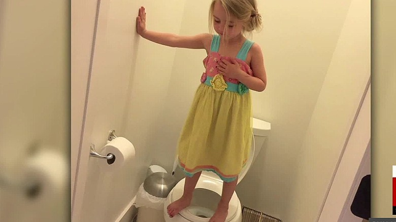 Girl stands on toilet as part of pre-school gun drill
