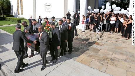Pallbearers carry the casket of Brenda Lee Marquez-McCool in Orlando after her funeral service.