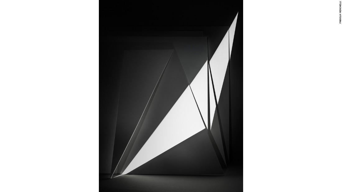 "Mexican artist Fabiola Menchelli manipulates light and architecture, using unconventional techniques and multiple exposures to craft her geometric monochrome photographs.<br /><br />Pictured: ""Balancing Light"" (2013)"