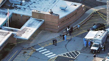 Adam Lanza, 20, guns down 20 children, ages six and seven, and six adults, school staff and faculty, before turning the gun on himself. Investigating police later find Nancy Lanza, Adam's mother, dead from a gunshot wound. The final count is 28 dead, including the shooter.