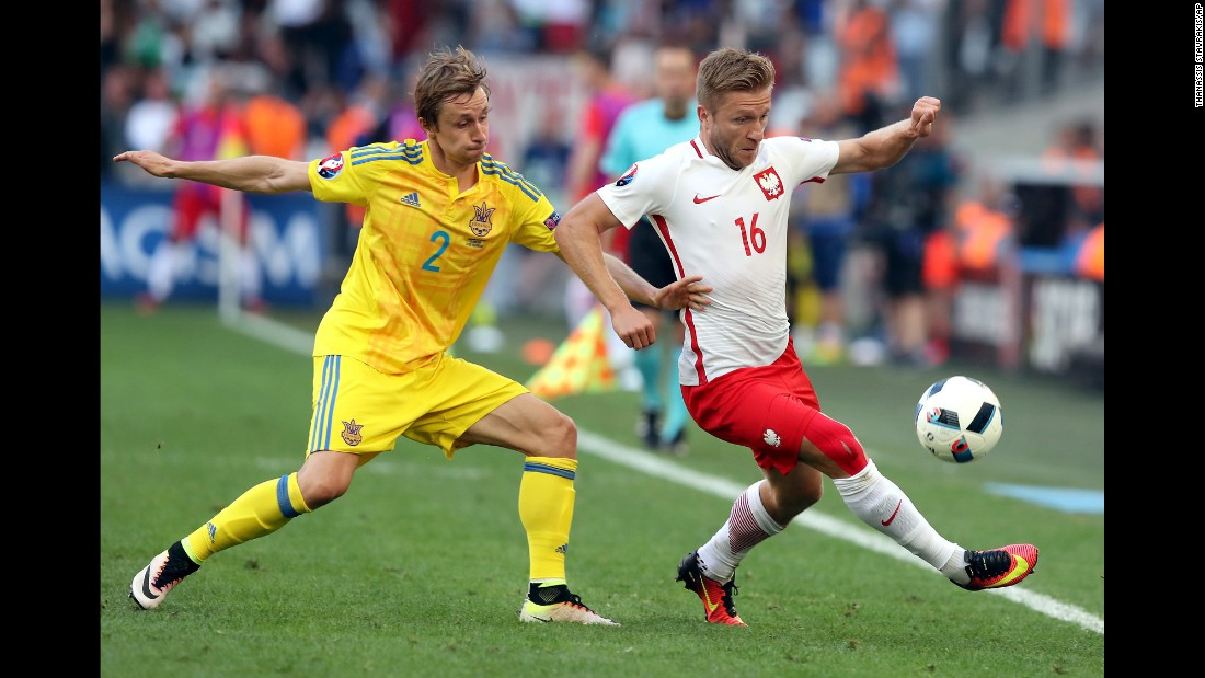 Ukraine's Bohdan Butko tussles with Blaszczykowski.