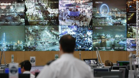 LONDON - DECEMBER 31:  A bank of television monitors displays images captured by a fraction of London's CCTV camera network within the Metropolitan Police's Special Operations Room on December 31, 2007 in London, England. The operations room, believed to be the largest of its kind, is on high alert in preparation for New Years Eve celebrations in London.  (Photo by Daniel Berehulak/Getty Images)