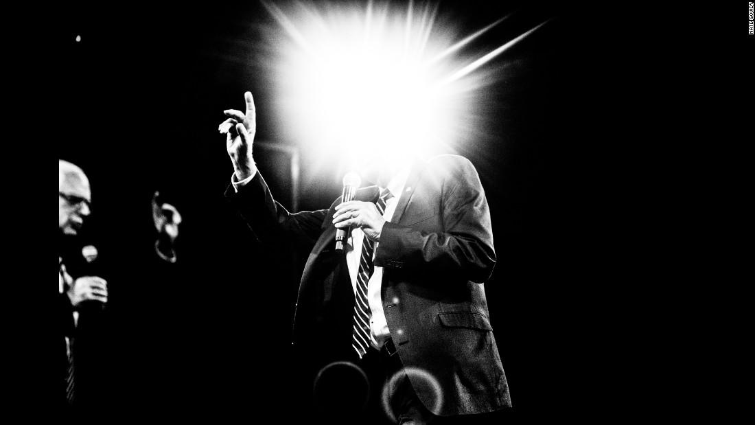 A flash of light obscures the head of U.S. Sen. Bernie Sanders as he speaks in Des Moines, Iowa, in October.