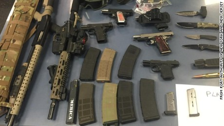 Port Authority police seize handguns and rifles after searching a car en route to New York City.