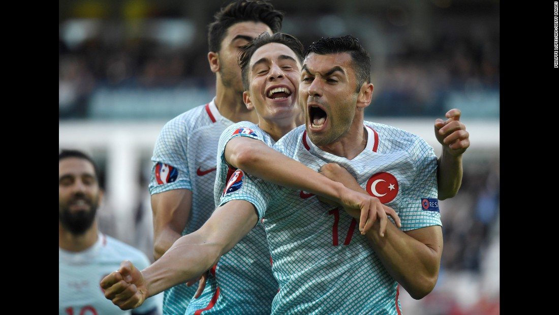 Turkish forward Burak Yilmaz, right, is congratulated by teammates after scoring the opening goal against the Czech Republic in Lens, France. Turkey won 2-0 and finished third in Group D. It could qualify for the knockout stage depending on other results in the tournament.