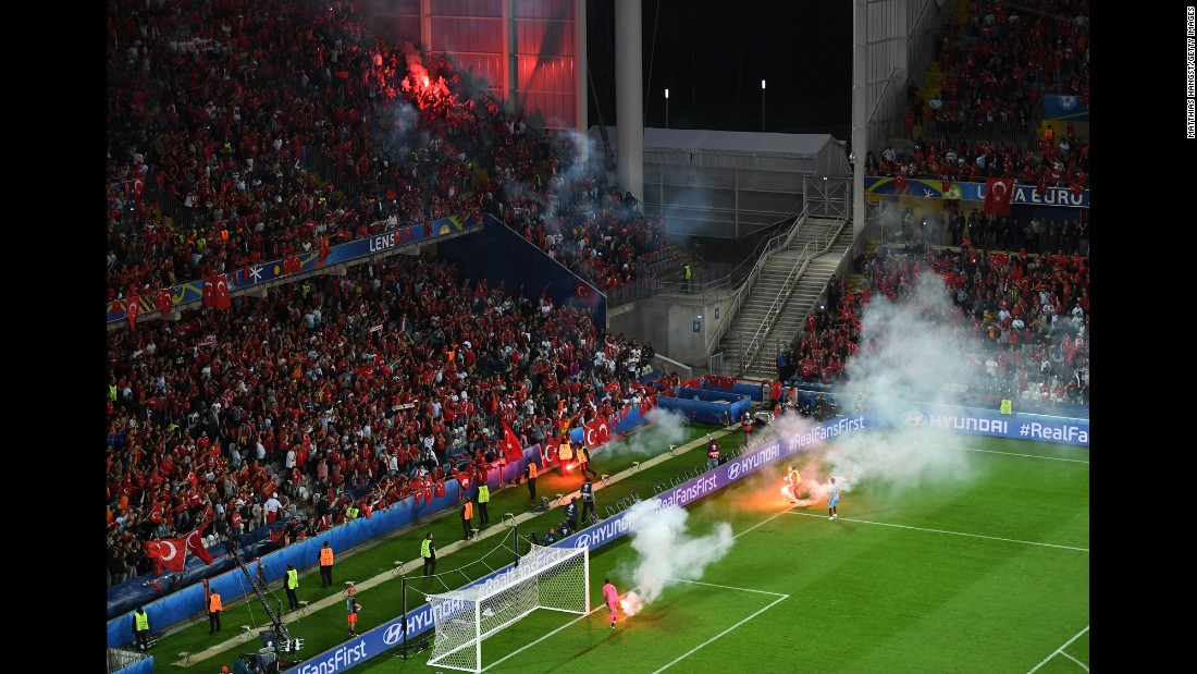 Flares were thrown on the field near Turkey's fans.