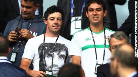 Northern Irish golf star Rory McIlroy (L) was watching his compatriots at Parc des Princes.