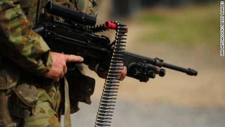 An Australian soldier is seen carrying a Minimi machine gun as part of exercise Talisman Sabre on July 9, 2015, in Rockhampton, Australia. Talisman Sabre is a biennial military exercise that trains Australian and U.S. forces to plan and conduct combined task force operations to improve combat readiness and interoperability on a variety of missions from conventional conflict to peacekeeping and humanitarian assistance efforts. TS15 will incorporate force preparation activities, Special Forces activities, amphibious landings, parachuting, land force manoeuvre, urban operations, air operations, maritime operations and the coordinated firing of live ammunition and explosive ordnance from small arms, artillery, naval vessels and aircraft.