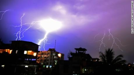 Lightning illuminates the night sky during a storm over Guwahati, India on April 18, 2016.