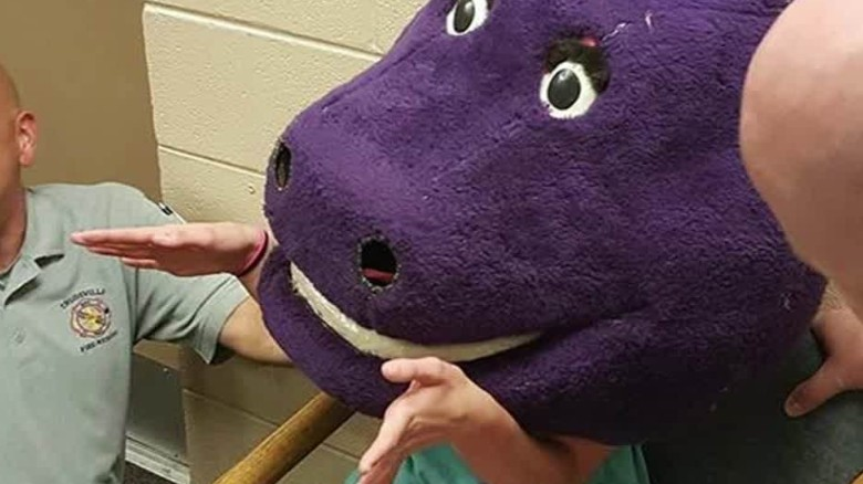 Girl gets stuck in massive Barney mask
