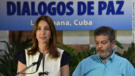 Colombian spokeswoman Marcela Duran and the FARC's Marcos Calarca speak Wednesday in Havana.