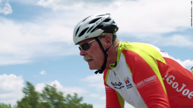 Man on bike races train for Parkinson's cause