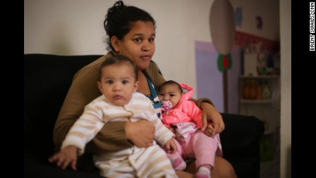 Jacqueline Silva de Oliveira with her twins, Lucas and Laura.
