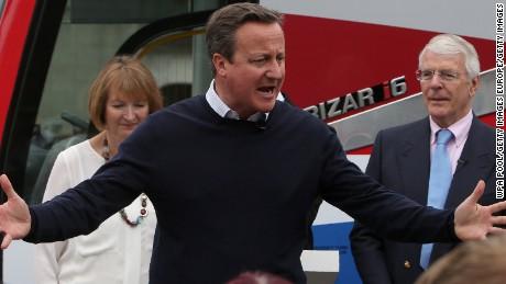 British Prime Minister David Cameron addresses a Bristol rally Wednesday with Harriet Harman and John Major.