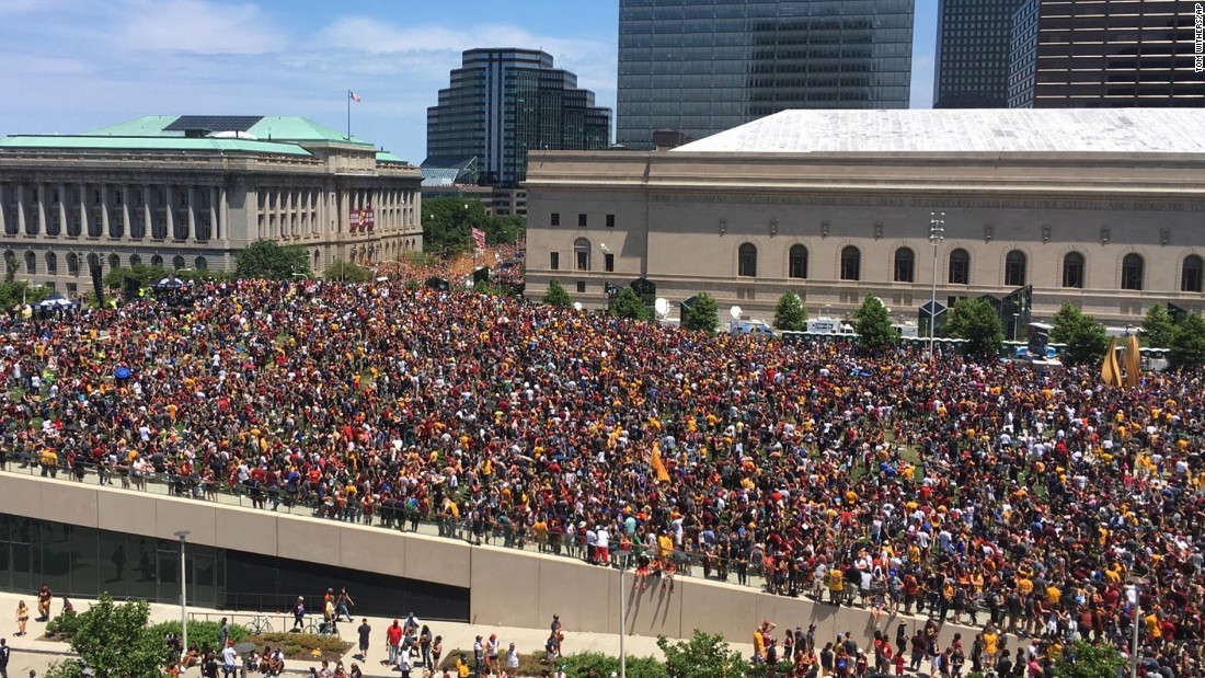 "Fans gather to watch the parade in Cleveland. The city hadn't won a major sports title since 1964. <a href=""http://www.cnn.com/2016/06/20/sport/gallery/cities-longest-championship-droughts/index.html"" target=""_blank"">See other championship droughts</a>"