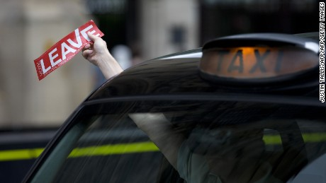 "A taxi driver holds a sticker for the ""Vote Leave"" pro-Brexit campaign as he drives past media in central London on June 22, 2016, ahead of the June 23 EU referendum. Rival sides threw their efforts into the final day of campaigning Wednesday, on the eve of Britain's vote on EU membership that will shape the future of Europe.  / AFP / JUSTIN TALLIS        (Photo credit should read JUSTIN TALLIS/AFP/Getty Images)"
