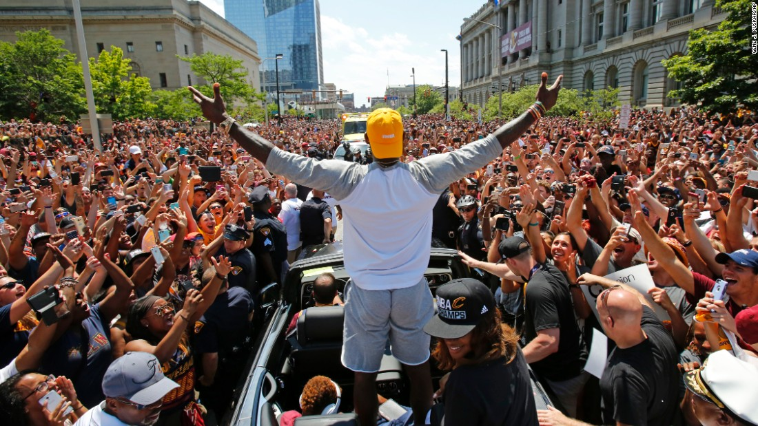 "Cleveland Cavaliers star LeBron James stands in the back of a Rolls Royce as it makes its way through a victory parade in downtown Cleveland on Wednesday, June 22. The Cavaliers <a href=""http://www.cnn.com/2016/06/19/sport/gallery/nba-finals-game-7/index.html"" target=""_blank"">won their first NBA title</a> on Sunday."